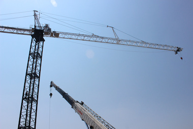 The crane towered over the construction site on a quiet, lakefront block.