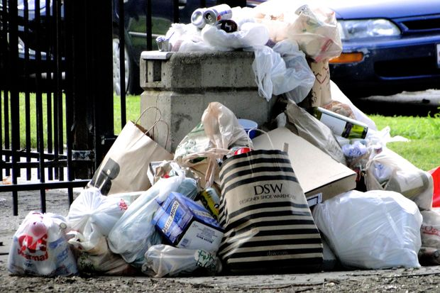 Personal garbage bags go in the dumpster, not public trash cans, officials said.
