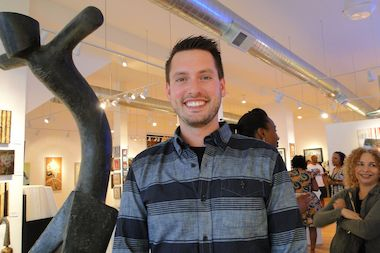 Tristan Pollock, co-founder of Storefront, is shown at Wicker Park's Jackson June Gallery, one of several places available for rent on Storefront.com.