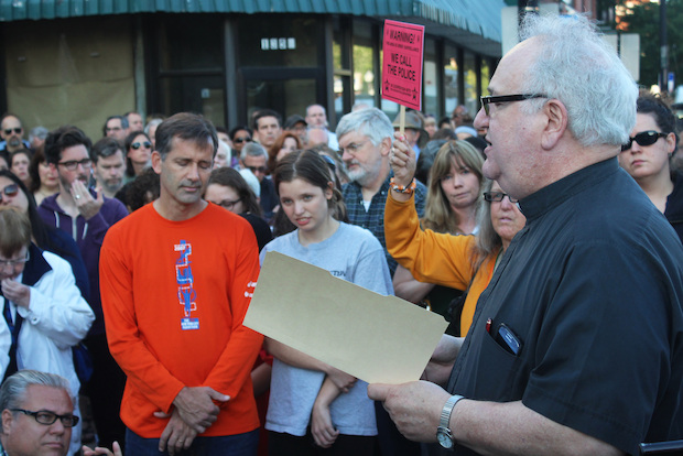 Aldermen, clergy and hundreds of residents gathered on Devon Avenue Wednesday night in honor of Rogers Park photographer Wil Lewis.