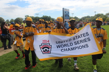 The Jackie Robinson West players and coaches celebrated on their home field before a parade in their honor stepped off in 2014.
