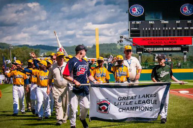 Jackie Robinson West's players wave to the crowd at the Little League World Series opening ceremonies.