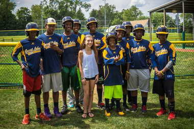 Jackie Robinson West Little Leaguers pose with a fan prior to the Little League World Series.