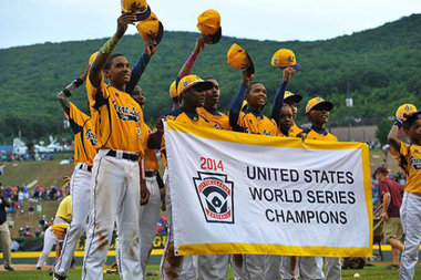 Members of the Jackie Robinson West baseball team celebrate after their 7-5 win over Las Vegas during the U.S. Championship game of the Little League World Series at Lamade Stadium Saturday in South Williamsport, Pennsylvania.