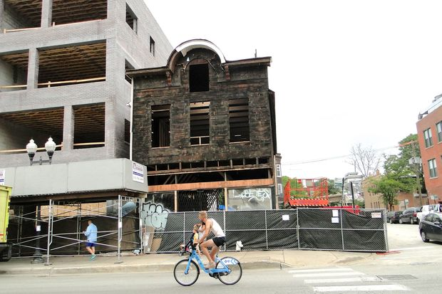 An 1880s-era wood frame building in Wicker Park is being renovated but in the meantime, passerby are being treated to a glimpse of the past.