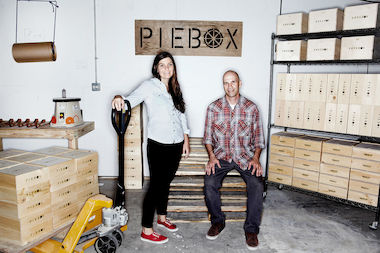 Adrienne Blumthal (l.), the creator of PieBox, stands in her Northwest Side manufacturing facility and warehouse with her photographer husband Steve Metzer.