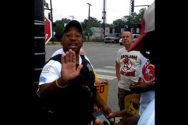 "Citizens to Abolish Red Light Cameras posted a video online of a protest at 119th and Halsted streets recently that shows Chicago Police Sgt. Herbert Brown Jr. calling demonstrator's signs ""slanderous"" and then threatening to arrest at least one demonstrator."