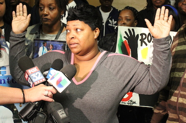 Cynthia Lane demonstrates how she believes her son, Roshad McIntosh, was acting when shot by Chicago Police.