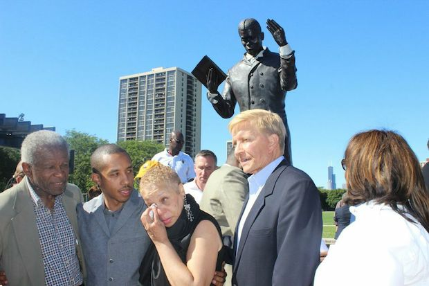 The statue unveiled at  Dunbar Park , 200 E. 31st St., depicts the poet 6-feet tall in bronze clasping his first book.
