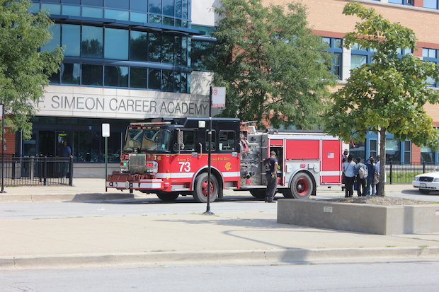 A chemical explosion injured two people and caused the evacuation of Simeon Career Academy Friday.