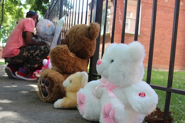 Neighbors create a sidewalk memorial for four children who died in a Roseland fire last September in Roseland.