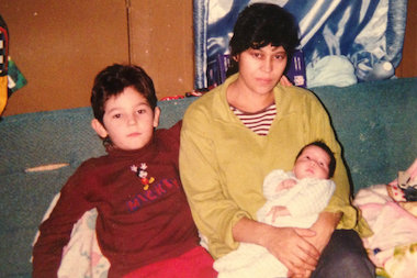 Jesus Torres (l.) when he was 6 years old posing with his mother Evangelina Alvarez and newborn sister Brenda in December 1999. Torres and his mother, with other relatives, illegally immigrated to the United States from Mexico in April 1999 when he was 5 years old. Torres is a senior soccer star forward for the UIC Flames.