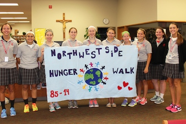 Officers of the Resurrection College Prep High School Key Club and Celtic Club created the banner for the Northwest Side Hunger Walk, which will take place Sept. 28.