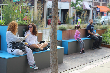 City-dwellers enjoying the pop-up hangout outside Akira Andersonville at 5228 N. Clark St.