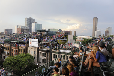 Fans watch the Cubs play from rooftops in Wrigleyville.