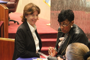 Aldermen Margaret Laurino and Carrie Austin, chairman of the Budget Committee, talk before Friday's hearing.