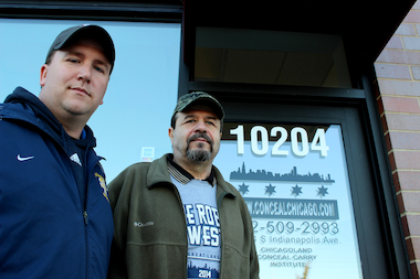 Father and son Anthony (r.) and Tony Burmistrz own Chicagoland Conceal Carry Institute in the East Side neighborhood.