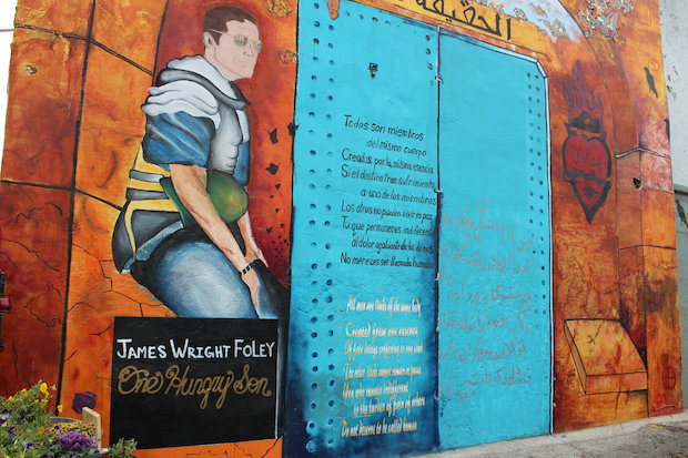 To honor their fallen friend, a group of James Foley's closest friends recently dedicated a mural on 18th Street in Pilsen to his memory. The mural covers a full building wall at Pilsen Vintage and Thrift.
