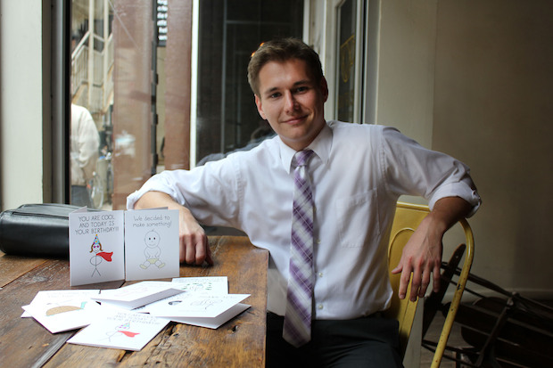 "Adam Levitus, 26, designs ""Pithy Diction"" cards in his Lakeview apartment."