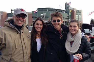 James Geier poses outside of Lambeau Field with his wife of 18 years, Amy, and their children, Olivia and Jasper, a sophomore and eighth-grader, respectively, at Latin School of Chicago.