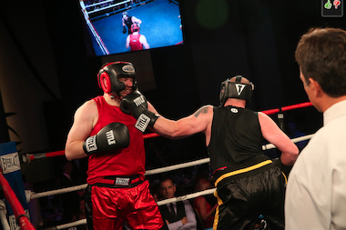 Chicago Teachers Union field representative Joey McDermott takes one in the face for charity at Mercy Home's fight night fundraiser.