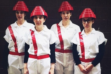 The ladies of Sparrow in Logan Square dressed as Devo for Halloween.