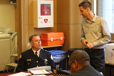 Police Supt. Garry McCarthy talks with Ald. Nicholas Sposato before Thursday's budget hearing.