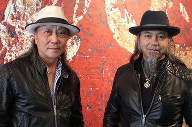 Shan Zuo and Da Huang Zhou pose for a portrait at their Bridgeport gallery.