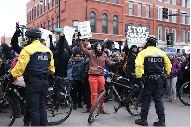 Chicagoans protest the Ferguson verdict during a march through the city Friday.