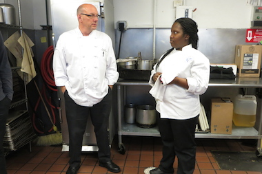 Metropolitan Club chef Greg Carso talks with cook Dale Wilson, who is a student at Carso's alma mater, Washburne Culinary Institute.