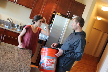 Alia Dala, a personal chef, gets instructions on using the food scraps bucket from Jonathan Scheffel.