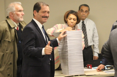 "Cook County Commissioner Jesus ""Chuy"" Garcia presents his petitions to enter the 2015 mayorl race Monday."