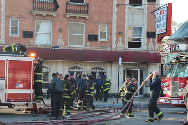 Four people were injured when the East Garfield Park hotel caught fire Saturday morning.