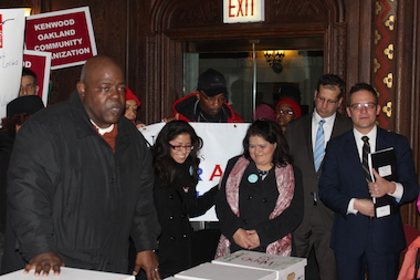 Aldermen John Arena and Joe Moreno (r.) backed Jitu Brown as they prepared to submit petitions to put a referendum for an elected school board on the ballot in 38 wards.