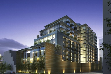 A nighttime rendering of the proposed 13-story development at 111 S. Peoria St. across from Mary Bartelme Park.