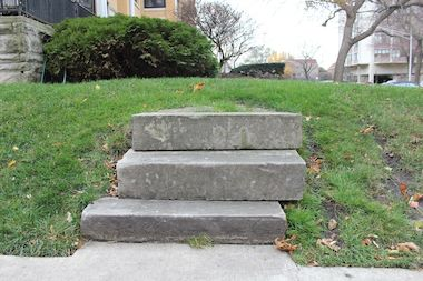 University of Chicago officer Larry Torres claimed he fell down three limestone stairs onto his backside and is seeking $500,000 from the homeowners.