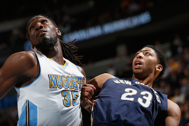 Kenneth Faried (35) of the Denver Nuggets and Anthony Davis (23) of the New Orleans Pelicans battle for rebounding position at Pepsi Center on Nov. 21, 2014 in Denver.