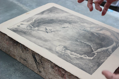 An image drawn on a lithography stone with grease pencil. Once the image has been printed, the stone will be ground down until the drawing is erased, and the stone is ready for another litho.