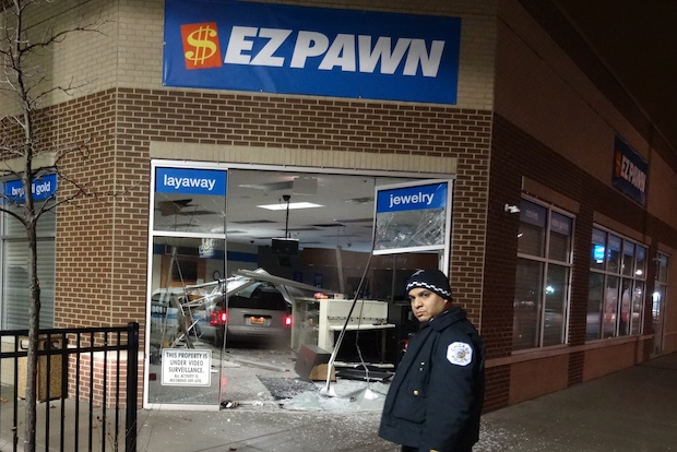Thieves crashed a minivan into a pawn shop just before 4 a.m. Tuesday, police said.