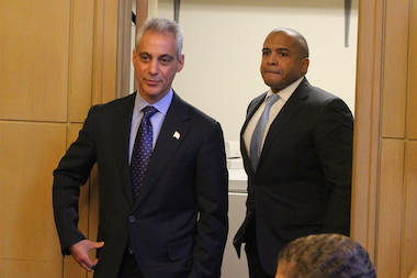 Mayor Rahm Emanuel and Ald. Will Burns emerge from a side room after consulting before Tuesday's special City Council meeting on the minimum wage.