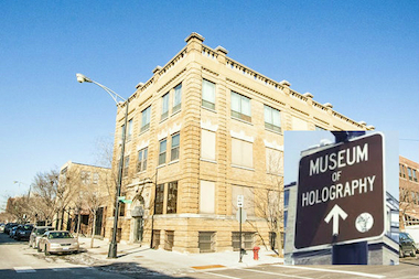 A sign marks the route to the now defunct Museum of Holography near Washington Boulevard and Racine Avenue.