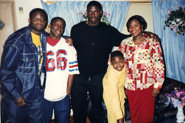 Charles (from l.), Michael, Victor, James and Deborah Adeyanju are shown during James' 10th birthday at their Gage Park home. Victor Adeyanju, now 31, serves as a database analyst for Best Western Hotels in Arizona after playing in the NFL for four-plus years.