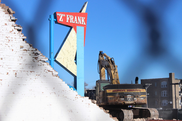 The 50-foot-tall retro sign on Western Avenue is set to be torn down and scrapped if no one takes it.