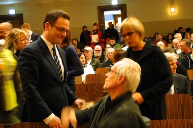 Ald. Joe Moreno (1st) greets a former West Town resident Pete Frisbie at the debates Thursday.
