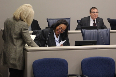 Ald. Leslie Hairston (5th) smiles as Ald. James Balcer (11th) passes her ordinance through committee Tuesday.