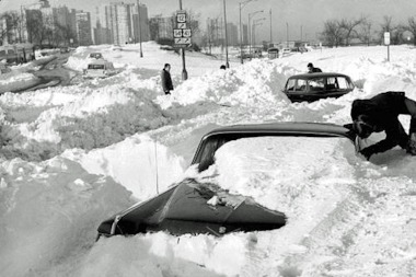 A 1964 Cadillac being dug out of the snow near Lake Shore Drive and Foster on Jan. 27, 1967.