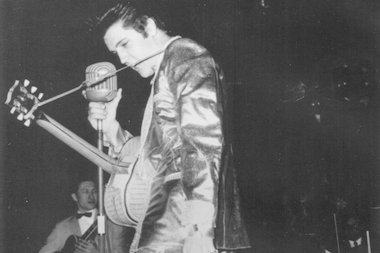 Elvis Presley rocked the world of 13,000 adoring fans at the International Amphitheatre in the Union Stockyards.
