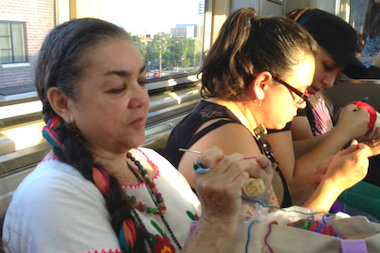 Among the more creative Go program events: A group knitting session on the Pink Line at part of Go Pilsen.