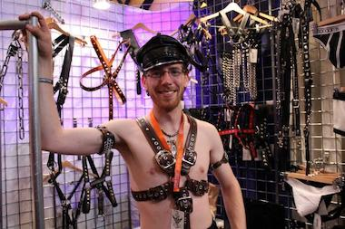 "A Mr. Leather vendor models his made-to-order attire. ""Not everyone is a small, medium or large,"" he said. ""Most people are in-between."""