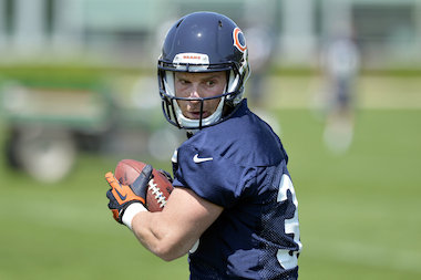 Running back Jordan Lynch of the Chicago Bears works out during rookie minicamp at Halas Hall last May in Lake Forest. Lynch, a star at Mount Carmel and Heisman Trophy finalist at Northern Illinois, was waived by the Bears in the preseason last year.